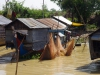 Huizen op palen in de rivier