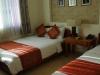 Ruime kamer met grote bedden