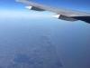 Het vliegtuig vliegt boven Wales, langs Londen, rechtstreeks aan op de Polderbaan