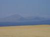Zand, water en daarachter nog meer zand