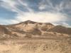 Het landschap verandert, zandduinen gaan over in uitlopers van de Andes