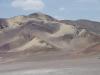 Twintig kilometer ploegen we door het zand en verkennen het terrein van de Dakar ralley