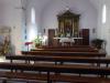 In de kerk van Melide halen we een mooie stempel en steken een kaarsje aan