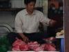 De vleesverkoper
