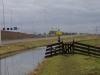 Pad over de dijk naast de uitwatering
